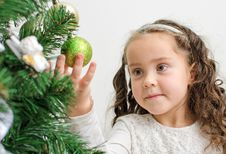 Little Girl Decorates Tree Royalty Free Stock Photo