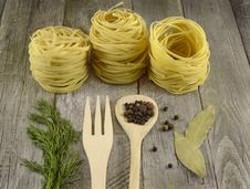 Free Rolled Noodles With Spoon And Fork Royalty Free Stock Photography - 35564797