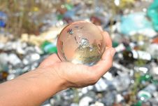Free Globe In Hands On Garbage Background. Royalty Free Stock Photos - 35566908