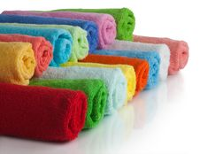 Set Of Colored Towels On White. Stock Photos