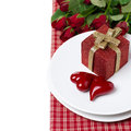 Free Red Gift Box And Two Hearts On A Plate, Roses In The Background Royalty Free Stock Photo - 35573875