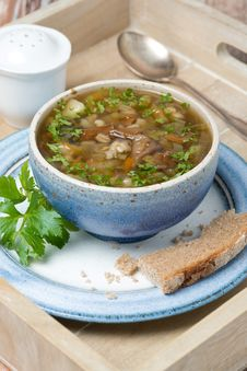 Bowl Of Mushroom Soup With Pearl Barley On A Wooden Tray Stock Photography