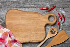 Free Figured Wooden Cutting Board, Spoon, Spatula And Spices Stock Images - 35573624