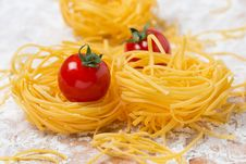 Free Italian Egg Pasta Nest, Cherry Tomatoes On A Board Royalty Free Stock Photo - 35573735