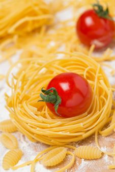 Free Italian Egg Pasta Nest, Cherry Tomatoes Royalty Free Stock Photography - 35573767