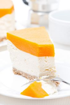 Piece Of Cheesecake With Pumpkin Jelly, Vertical, Close-up Stock Photo