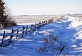 Free Wood Fence Along Snow Drifts Royalty Free Stock Photos - 35588298