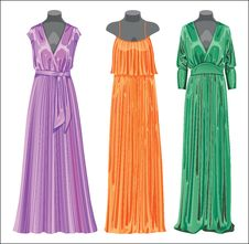 Set Of Three Long Evening Elegant Silk Dresses. Royalty Free Stock Photo