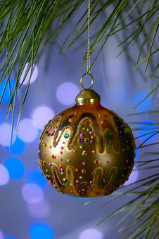 Free Gold Christmas Ornament On A Blue Background Stock Photography - 3561622