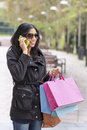 Free Woman Talking By Phone And Holding Shopping Bags. Royalty Free Stock Photography - 35602897