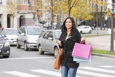 Beautiful Smiling Woman Crossing Street With Shopping Bags And P Royalty Free Stock Images