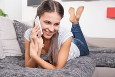 Free Cute Young Woman Talking On A Phone Royalty Free Stock Photography - 35618057