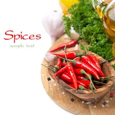 Free Fresh Chili Pepper Garlic, Spices And Oil On A Board Stock Images - 35619274