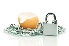 The Shell Of An Egg,covered With A Chain Padlock.