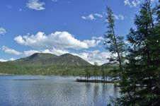 Landscape With A Lake And Mountains Along The Banks. Royalty Free Stock Images