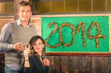 Free Couple Of Lovers Celebrating New Year 2014 Stock Photos - 35632173