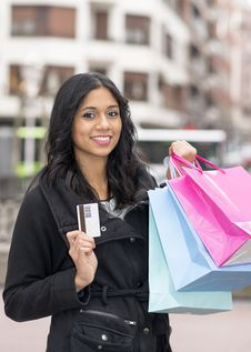 Free Woman With Credit Card And Shopping Bags. Royalty Free Stock Image - 35649276