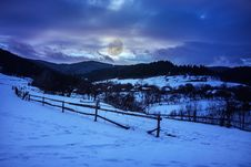 Free Fence By The Road To Snowy Forest In The Mountains Royalty Free Stock Images - 35649549