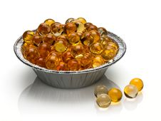 Free Pills With Cod-liver Oil Royalty Free Stock Image - 35652546