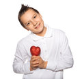 Free Teenager With A Heart In Hands Smiles Stock Photo - 35660870
