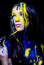 Free Beauty/fashion Close Up Portrait Of Woman Painted Blue And Yellow With Brushes And Paint  On Black Background Royalty Free Stock Images - 35662709