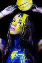 Free Beauty/fashion Close Up Portrait Of Woman Painted Blue And Yellow With Brushes And Paint  On Black Background Royalty Free Stock Image - 35662756