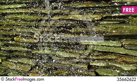 Free Waterfall Flowing Over A Rocky Wall Stock Photography - 35662622