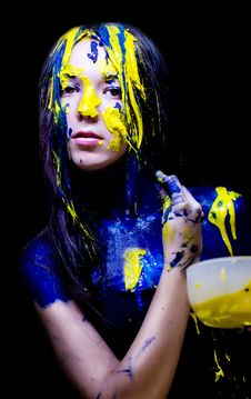 Beauty/fashion Close Up Portrait Of Woman Painted Blue And Yellow With Brushes And Paint  On Black Background Stock Image
