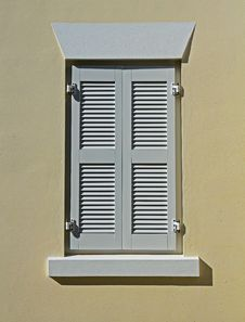 White Window Shutters On A Cream Wall Royalty Free Stock Photos