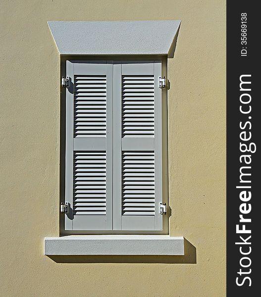 White Window Shutters on a Cream Wall
