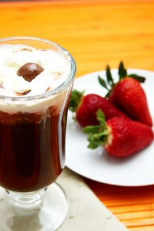 Cup Of Coffee With Strawberries Stock Photo