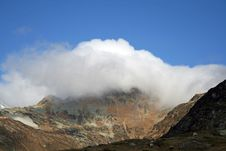 Free Mountain Covered By Clouds Royalty Free Stock Image - 3574836
