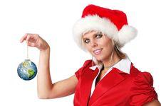 Santa Girl Holding Earth Ornam Stock Photography