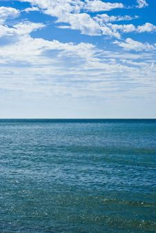 Free Calm Waves And Cloudy Blue Skies Stock Photo - 3577910