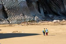 Two Women Walking On The Beach Royalty Free Stock Image