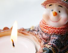 Snowman With Candle Royalty Free Stock Photo