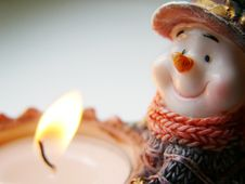 Snowman With Candle Royalty Free Stock Photos
