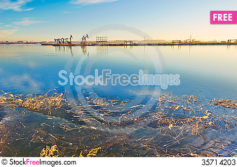 Free The Winter Ice Lake And Oil Suck Machine Stock Photos - 35714203