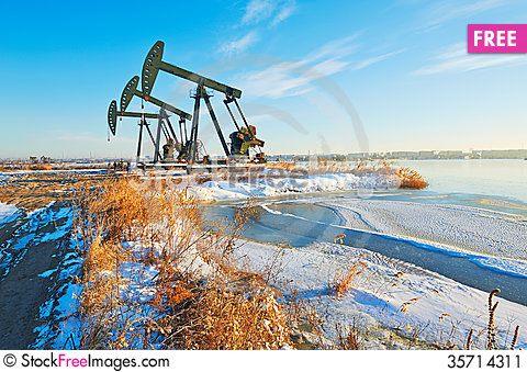 Free The Oil Sucking Machine And Snow Stock Image - 35714311