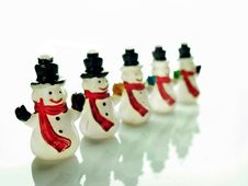 Free Small Snowmen Over White Royalty Free Stock Photos - 35710768