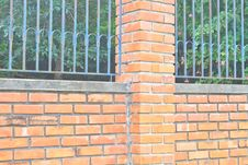 Old Brick Wall And Iron Fence Royalty Free Stock Photos
