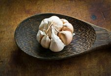 Free Garlic With Peel On Ladle Stock Image - 35721831
