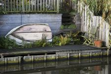 Free Boat Waiting In The Garden Stock Images - 35722974