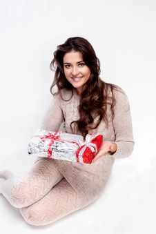 Happy Girl Giving You Christmas Present On White Background Royalty Free Stock Photos