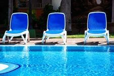 Free Chairs By The Pool Royalty Free Stock Image - 35759236