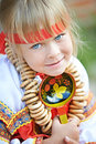 Free Girl With Spoon And Bagels Royalty Free Stock Photography - 35763077