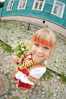 Free Russian Girl In National Costume With Bagels And Flowers Stock Images - 35763284