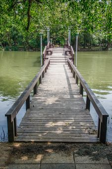 Free Wooden Bridge Over Pond Royalty Free Stock Images - 35766999