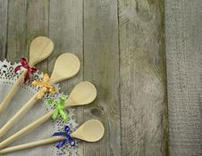 Free Four Spoons On Wooden Background Stock Images - 35767384