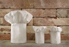 Three Chef S Toques On Brick Wall Royalty Free Stock Image